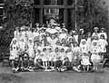 "Group Picture of children at Ursuline Convent, Ireland, 1920s, sign labelled ""The Dolls Hospital""(5727432569).jpg"