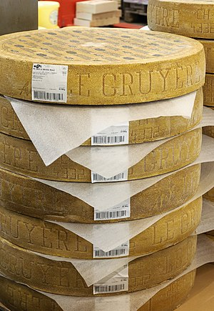 Gruyère cheese - Rounds of Gruyère cheese on sale in a wholesale food market in France