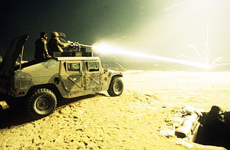 Tracer ammunition - Tracer rounds fired from a .50 caliber M2HB heavy machine gun mounted on a HMMWV ricochet off a decommissioned tank being used as a training target at the Air Mobility Warfare Center.