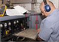 Henry Castro, with the U.S. Air Force's 361st Training Squadron, checks the gas turbine generator wiring diagram panel to troubleshoot an electrical problem June 8, 2011, at Sheppard Air Force Base in Wichita 110608-F-NS900-023.jpg