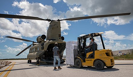 Unloading supplies from a Chinook helicopter in the Bahamas following Dorian, Sept. 9, 2019 Hurricane Dorian Response 190909-A-BG476-092.jpg