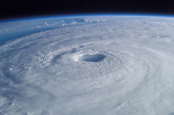 Hurricane Isabel (2003) as seen from orbit during Expedition 7 of the International Space Station. The eye, eyewall, and surrounding rainbands, characteristics of tropical cyclones in the narrow sense, are clearly visible in this view from space. Hurricane Isabel from ISS.jpg