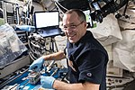 ISS-56 Ricky Arnold collects microbe samples in the Harmony module.jpg