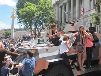 Independence Day (Georgia) - People posing at military hardware displayed in Tbilisi on 26 May 2014.