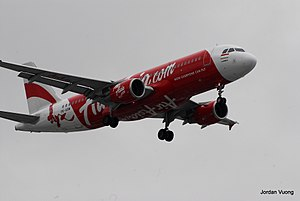 Indonesia AirAsia Airbus a320 on approach to Perth Airport.jpg