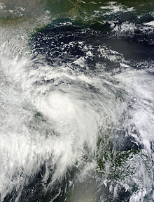 A visible satellite image of a tropical storm approaching hurricane intensity in the Bay of Campeche.