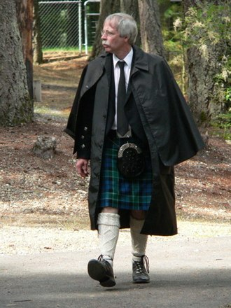 Cape - Inverness cape, a sleeveless topcoat, common with Highland dress.