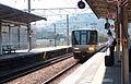 JRW 223 local approaching Yamazaki station 2014-09-09.jpg
