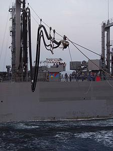 JS Hamana (AOE-424) prepares to send a refueling probe, -18 Dec. 2001 a.jpg