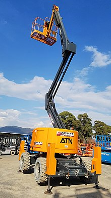 Jack Boom Lift (Zebra 16) with outriggers deployed and wheels suspended