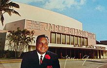 Autographed color photo of Gleason in front of Miami Beach Auditorium