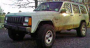Suspension lift - Jeep Cherokee with 2 inch Suspension lift on 31 inch BFG A/Ts, using add-a-leaf and coil spring spacers
