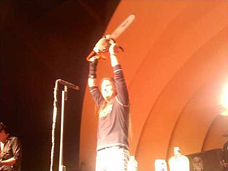 """Jackyl - Dupree of Jackyl holding chainsaw while performing """"The Lumberjack"""""""