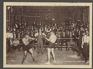 Jimmy Sharman - Jimmy Sharman Sr refereeing a boxing match between Prest and Lewis in the 1910s