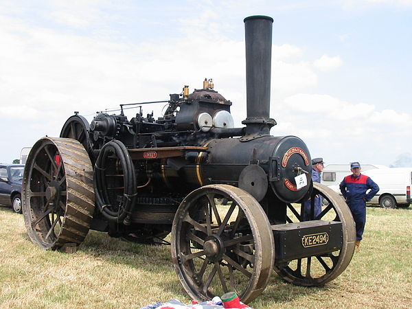 A John Fowler & Co. Ploughing Engine - the winding drum is mounted below the boiler (the 'drum' on the side is actually a hose for refilling the water tank).  A lockable tool box may be seen on the front axle; the 'spud tray' would be mounted in the same way, behind the axle.