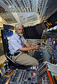 John Holdren sits in Space Shuttle Discovery soon to be decommissioned.jpg