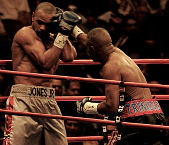 Félix Trinidad - Trinidad (right) throws a punch at Jones Jr.