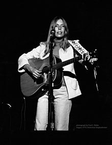 Joni Mitchell plays guitar in 1974
