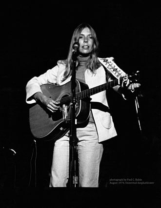 Joni Mitchell - Mitchell performing in concert at the Universal Amphitheatre in August 1974