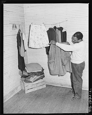 Julius Brooks, miner, in his four room house f...
