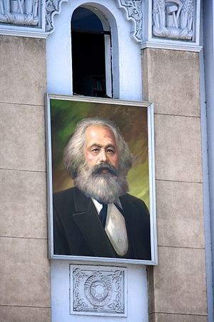 Communism in Korea - A portrait of Karl Marx on the wall of the Ministry of Foreign Trade. Marxism–Leninism has been phased out in North Korean politics and replaced by Juche