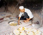 A Uyghur naan baker, Kashgar.