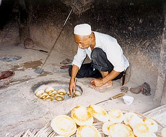 Uyghurs - A Uyghur girde naan baker