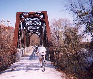 Katy Trail State Park - Cyclists crossing an erstwhile railroad bridge over the Femme Osage Creek near Defiance