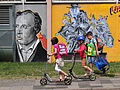 Kids on Scooters with Public-Art Backdrop - Giessen - Germany.jpg