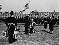 King George VI presenting the King's Colour to the Royal Canadian Navy during a ceremony in Beacon Hill Park.jpg