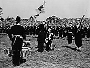 King George VI presenting the King's Colour to the Royal Canadian Navy during a ceremony in Beacon Hill Park