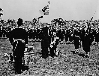 The Canadian Crown and the Canadian Armed Forces - King George VI presents the King's Colours to the Royal Canadian Navy at a ceremony in Beacon Hill Park, Victoria, Canada, 1939. Regimental, and King's/Queen's Colours are typically given to regiments and other units of the Canadian Forces.