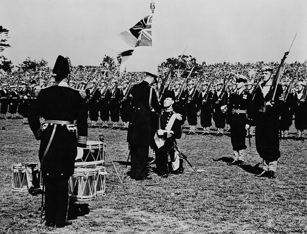 King George VI presenting the King%27s Colour to the Royal Canadian Navy during a ceremony in Beacon Hill Park