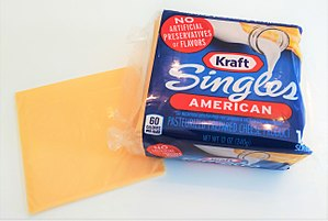 Kraft Singles - A package of Kraft Singles along with an individual slice.
