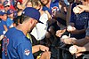 Kris Bryant signing autographs during his rehab assignment against Omaha (29379019607).jpg