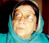 A photograph of an old woman wearing glasses.