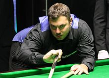 Kurt Maflin playing a shot with the rest
