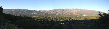 Panoramic view of San Gabriel Mountains from La Cañada Flintridge.  Jet Propulsion Laboratory, San Gabriel Peak and Mount Wilson can be seen.