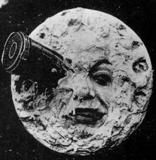 Georges Me;lis Le Voyage dans la Lune, showing a projectile in the man in the moon's eye from 1902