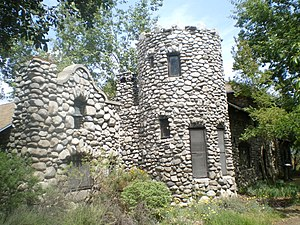 Lummis House - View of the stone facade with the bell.