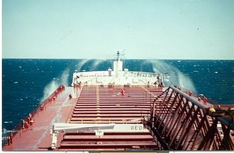 Lake freighter - 1000-footer George A. Stinson (now American Spirit) pounds through Lake Huron waves.
