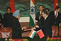 Manmohan Singh exchanging signed documents of an agreement on 'A Shared Vision for the 21st Century of the Peoples of Republic of China and the Republic of India' with the Chinese Premier, Mr. Wen Jiabao.jpg