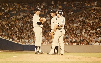Thurman Munson - Brad Gulden (with Billy Martin and Catfish Hunter) was one of two catchers to play in the game after Thurman Munson's funeral. His black memorial armband is visible.