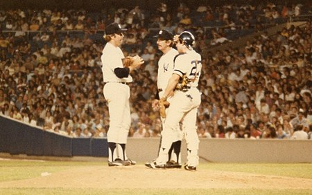 Brad Gulden (with Billy Martin and Catfish Hunter) was one of two catchers to play in the game after Thurman Munson's funeral. His black memorial armband is visible. MartinHunterGulden1979.jpg