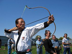 Composite bow - Master Heon Kim using a modern Korean composite bow.