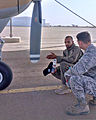 Mauritanian air force Master Sgt. Ahmed Beheitt, left, a Cessna 208 Grand Caravan crew chief, describes the aircraft to U.S. Air Force Maj. Michael Simons, the lead planner of African Partnership Flight 140901-F-FV908-022.jpg