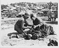 Medical Corpsman gives first aid to wounded North Korean (NCP 011268), National Museum of Health and Medicine (3789619937).jpg