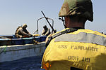 Members of the U.S. Coast Guard law enforcement detachment and Combined Task Force 151's visit, board, search and seizure team, assigned to the guided-missile destroyer USS Farragut (DDG 99), prepare to board 100331-N-OM347-085.jpg