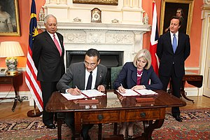 "Transnational crime - Foreign and Commonwealth Office. Home Secretary Theresa May with Malaysia Minister of Home Affairs Dato' Seri Hishammuddin Tun Hussein sign a ""Memorandum of Understanding on transnational crime"", 14 July 2011."