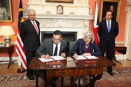 May, David Cameron and Najib Razak, 14 July 2011 Memorandum of Understanding on transnational crime (5937407114).jpg
